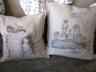 Coral and Tusk embroidered pillows
